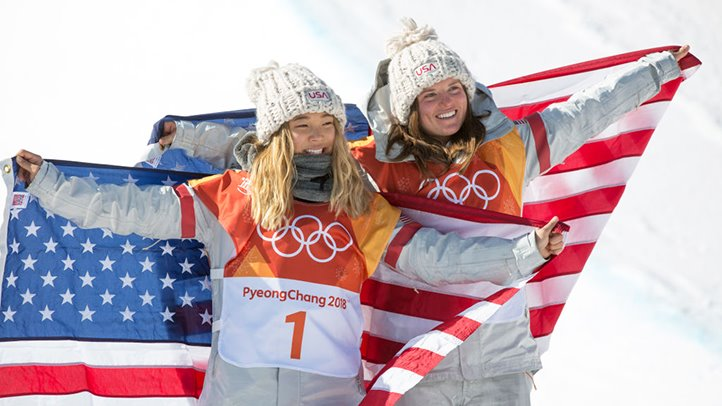 Snowboarder Chloe Kim (left) poses with Arielle Gold after they won gold and bronze, respectively, in the half-pipe event at the 2018 Olympics.